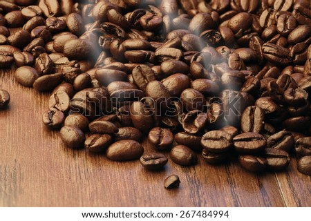 Fresh roasted coffee beans - stock photo