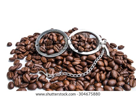 fresh roasted coffee beans and strainer - stock photo