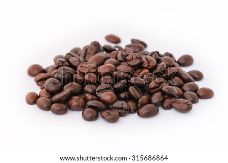 Fresh roasted coffee beans in coffee shot glass.