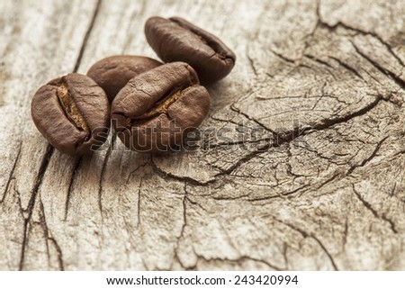 fresh roasted coffee beans over weathered wood - stock photo