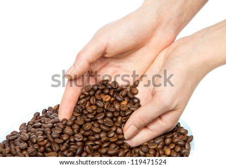 Fresh roasted coffee beans pouring out of cupped woman hands on a white background - stock photo