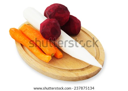 Fresh Root Vegetables on Wooden Board. Isolated on White Background.