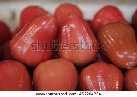 Fresh Rose apples  or chomphu fruit  is very much on the market background            - stock photo