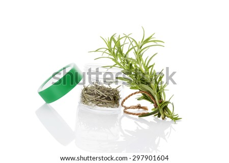 Fresh rosemary herbs and dry rosemary spice in glass jar isolated on white background. Culinary healthy aromatic herbs. Culinary arts. - stock photo