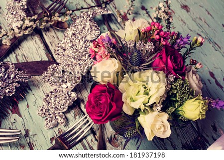 Fresh roses and white flower bouquets in romantic style on grunge table with bridal jewelry - stock photo