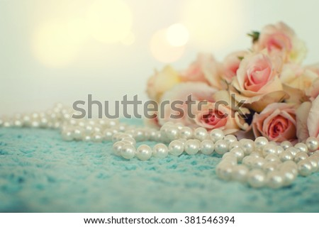 Fresh roses flowers with pearls - stock photo