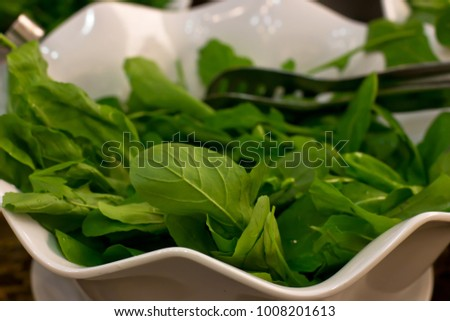 Fresh rucola leaves close-up in the white bowl