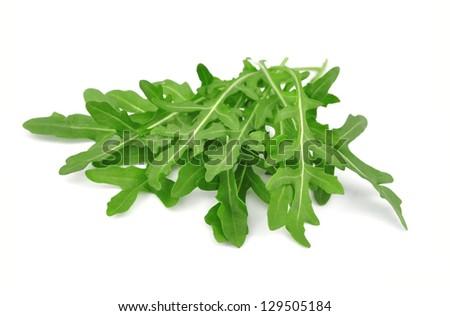 Fresh rucola leaves isolated on white - stock photo