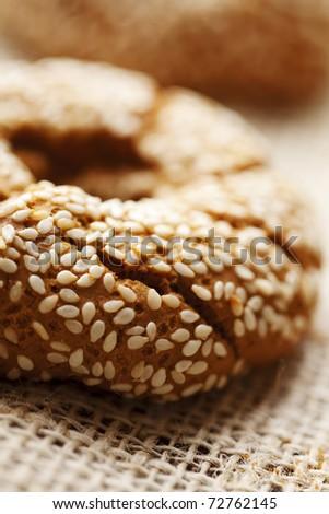 fresh rustic bread/bagels, shallow dof - stock photo
