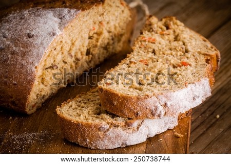 fresh rye bread closeup on a rustic wooden background
