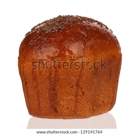 Fresh rye bread with caraway seeds with shadow over white background