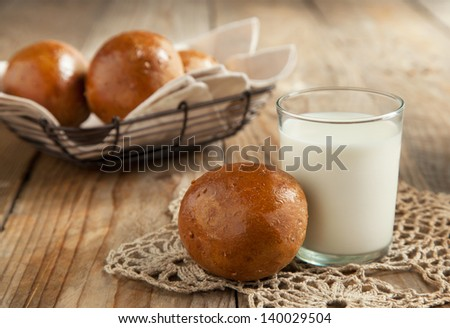 Fresh rye buns and glass of milk