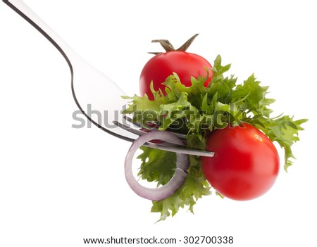 Fresh salad and cherry tomato on fork isolated on white background cutout. Healthy eating concept. - stock photo