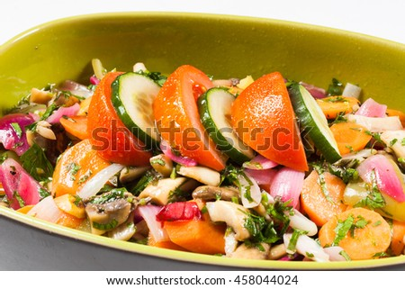 Fresh salad bowl filled with vegetables - stock photo