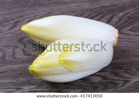 Fresh Salad chicory on the wood background