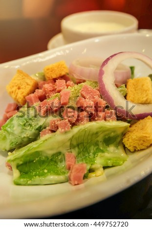 Fresh salad from vegetables, cheese and ham, lens flare light and selective focus. - stock photo