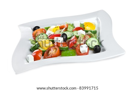 Fresh salad from vegetables on the white
