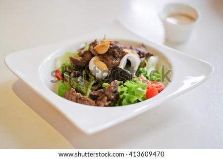 Fresh salad Healthy food on the table in the kitchen - stock photo