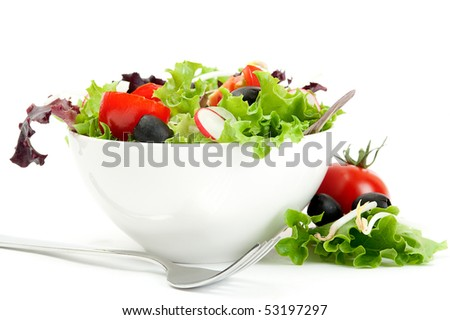 Fresh salad in a white bowl on a white background