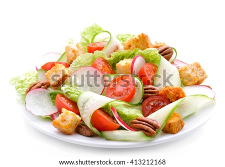 Fresh salad of cucumbers, radishes ,  chinese cabbage ,tomatoes ,pecans and croutons.Healthy food, diet nutrition - stock photo
