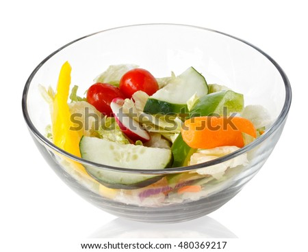 fresh salad of raw vegetables  in a glass bowl isolated on white background