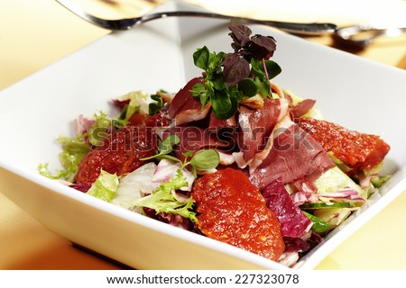 Fresh salad of smoked duck breast, lettuce and chutney - stock photo