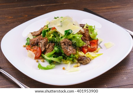 fresh salad of veal cooked delicious with grilled vegetables on white plate