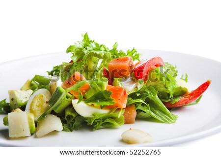 fresh salad on white plate isolated - stock photo
