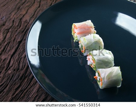 Fresh Salad Roll in Noodle Tube on A Dish on A Wooden Table