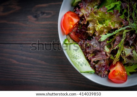 Fresh salad, vegetable organic healthy food on a wooden table - stock photo