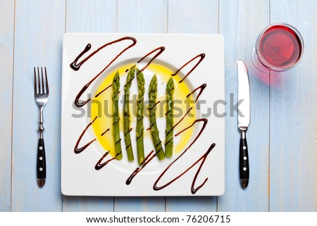 fresh salad with an open egg - stock photo