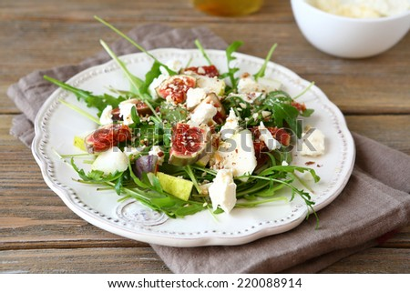 Fresh salad with arugula, figs, sliced �¢??�¢??cheese and pears, delicious food - stock photo