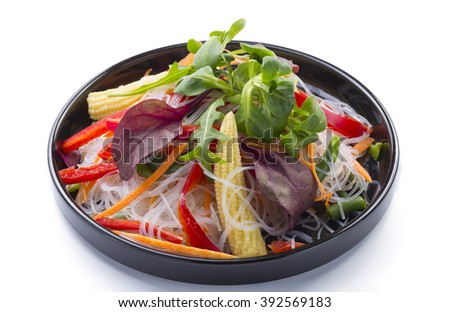 Fresh salad with baby corn and peas pepper and mix isolated on white background