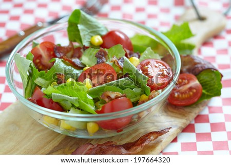 Fresh salad with bacon, lettuce, tomato and corn - stock photo