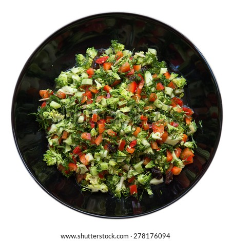 Fresh salad with broccoli, red pepper, fennel, raisins, sunflower seeds in black plate Isolated on white background - stock photo