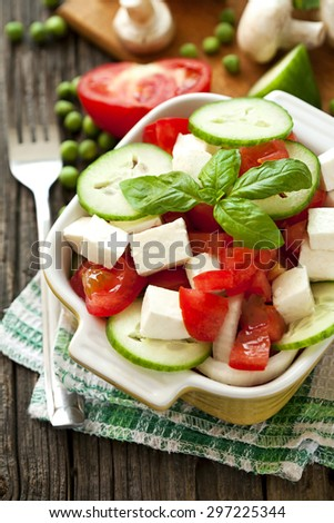 fresh salad with cheese - stock photo