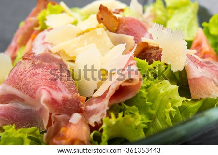 fresh salad with cheese and ham in plate