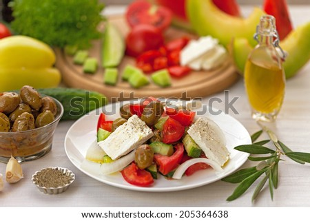 Fresh salad with cheese and olives