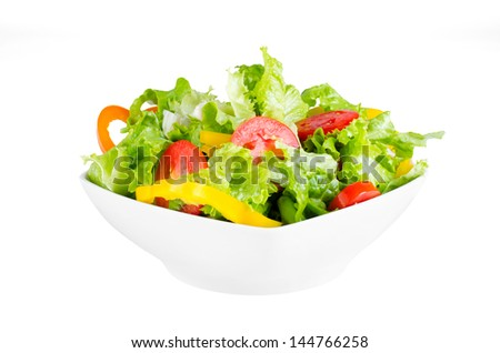 fresh salad with cherry tomatoes, peppers and lettuce in white bowl isolated on white with clipping path