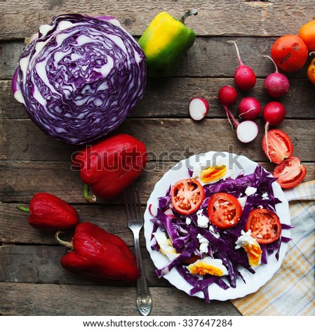 Fresh salad with cherry tomatoes, spinach,  in a plate on  wooden background, salad with vegetables and greens, fresh vegetable salad, food , breakfast. Top view. Food  background. Eggs. Radishes. - stock photo