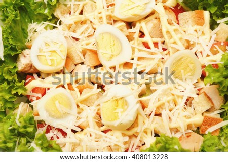 Fresh salad with chicken breast, cheese and eggs  close-up - stock photo