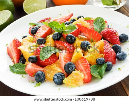 Fresh salad with different kinds of fruits and berries. Shallow dof. - stock photo