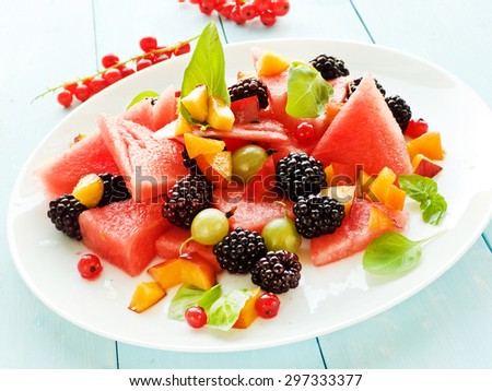 Fresh salad with different kinds of fruits and berries. Shallow dof.