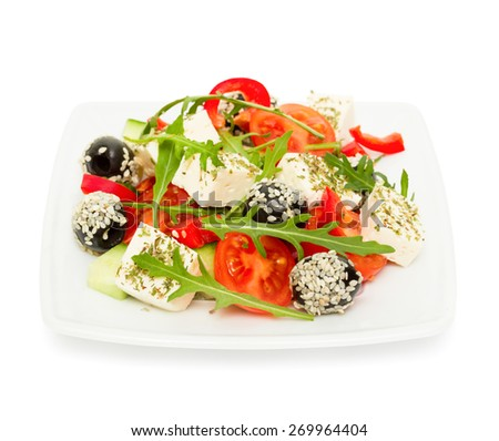 Fresh salad with feta cheese with herbs isolated on white