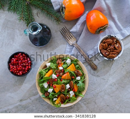 Fresh salad with fruits and greens on marble background. Healthy food. - stock photo