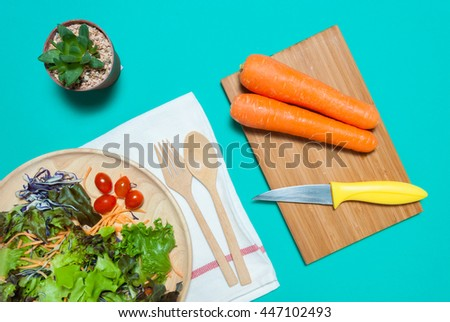 Fresh salad with fruits and greens on white green background top view. Healthy food.eat clean concept. Flat lay.