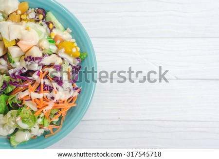Fresh salad with fruits and greens on white wooden background top view with space for text. Healthy food.eat clean concept. - stock photo