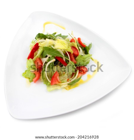 Fresh salad with ingredients isolated on white - stock photo