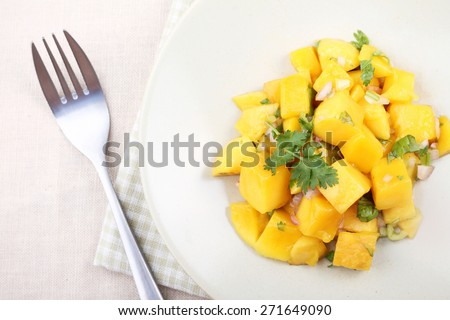 Fresh salad with mango, red shallot, green pepper and parsley - stock photo