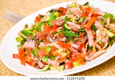 salad tortellini with tomato ham and omelette with mushrooms and